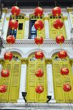 Hanging Asian Red Lanterns outside Chinatown House. Hanging Asian Red Paper Lanterns outside a House in Singapore's Chinatown Royalty Free Stock Image