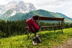 Hanging backpack and hiking shoes Stock Images