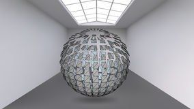 Hanging ball made of lots of smaller polygons in the large empty room. The exhibition space is the abstract object with Stock Images