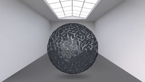 Hanging ball made of lots of smaller polygons in the large empty room. The exhibition space is the abstract object with Royalty Free Stock Photo