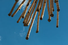 Hanging Bamboo Canes, Blue Sky in background Stock Image