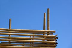 Hanging Bamboo Canes Close Each Other, Blue Sky in background Royalty Free Stock Photos
