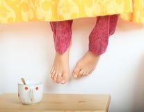 Hanging bare feet Stock Image
