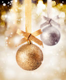 Hanging bauble with falling snow Stock Images
