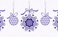 Hanging baubles. And snowflake unique pattern in background Royalty Free Stock Photo