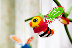 Hanging bees in baby room. Royalty Free Stock Photo