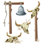Hanging bell and three bull skulls Royalty Free Stock Photography