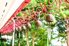 Hanging bells on red wire design and water drop of rain fall royalty free stock photo