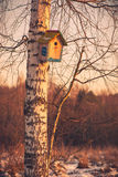 Hanging birdhouse Stock Images