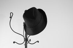 The hanging black hat Royalty Free Stock Photo