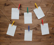 Hanging blank note tags with colored clothespins Royalty Free Stock Photos