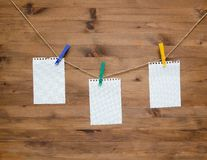 Hanging blank note tags with colored clothespins Royalty Free Stock Images