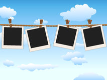 Hanging Blank photo frames on blue sky Stock Photo