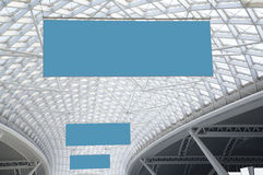 Hanging blank signs. Blank signs hanging on the ceiling Stock Image