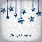 Hanging blue star decoration for Christmas holiday. Realistic blue star decoration for Christmas holiday. Realistic stars hanged with blue ribbon, floral pattern Royalty Free Stock Photo