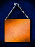 Hanging brass plate. Brass plate with steel chain hanging on a nail, on a dark blue grunge background. Just place your text Stock Photos