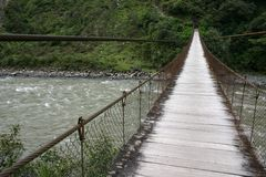Hanging bridge. Around Banos, Andes, Ecuador Royalty Free Stock Photos