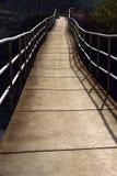 Hanging bridge. Bridge goes over river Stock Image