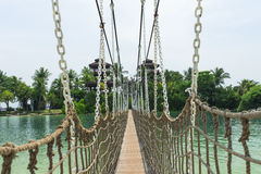 Hanging Bridge. Crossing at the tropical palawan beach Sentosa island in Singapore Stock Image