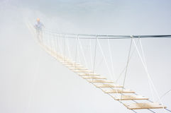 Hanging bridge in fog Royalty Free Stock Image