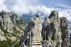 Hanging bridge in mountains royalty free stock photography