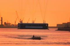 Hanging bridge and oarsmen at sunset. Hanging bridge and oarsmen at the sunset Royalty Free Stock Photo