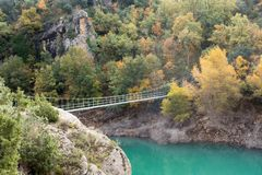Hanging bridge over river for crossing connecting two hills royalty free stock photos