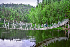 Hanging bridge over river Royalty Free Stock Image