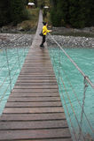 Hanging bridge over river stock images