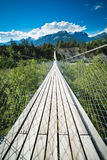 Hanging bridge over seasonal river Royalty Free Stock Photography