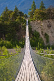 Hanging bridge over seasonal river Stock Photos