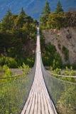 Hanging bridge over seasonal river Stock Photos