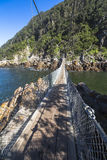 Hanging bridge over Storms River mouth, Tsitsikamma National Park Royalty Free Stock Images