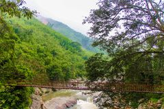 Hanging bridge in Sa Pa, Vietnam, during cloudy day stock images