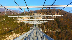 Suspension bridge in skypark Sochi, white rocks. Suspension bridge over the Ahshtyr gorges, white rocks, Skypark Sochi, skybridge Stock Photo