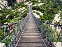 Hanging bridge in Songshan mountains, China. Dengfeng, China - July 28, 2013: Hanging bridge in sacred taoist Songshan mountains in Henan province, China Royalty Free Stock Photography
