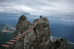 Hanging bridge in steep rocks royalty free stock photos