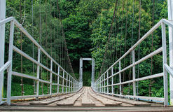 Hanging bridge. To the forest Royalty Free Stock Photo