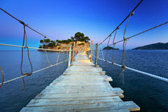 Hanging bridge to the island Royalty Free Stock Photography