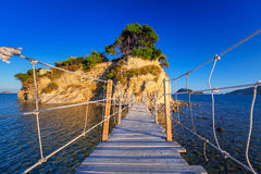 Hanging bridge to the island Royalty Free Stock Photo
