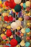 Hanging bright vivid colorful fabric ball LED string lights stock photos