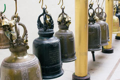 Hanging bronze bells in Wat Phrathat temple on Doi Suthep Royalty Free Stock Images