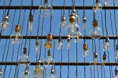 Hanging bulbs. With a sky background Stock Photography