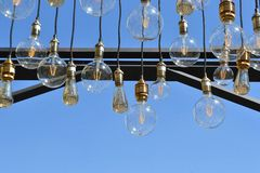 Hanging bulbs. With a sky background Royalty Free Stock Image