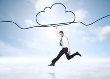 Hanging businessman. Businessman hanging on a cloud rope Stock Photos