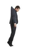 Hanging businessman looking down. Sad hanging businessman looking down. isolated on white background Royalty Free Stock Images