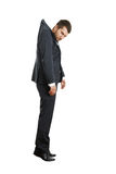 Hanging businessman. Offended hanging businessman looking at camera. isolated on white background Royalty Free Stock Photo