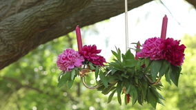 Hanging Candles Decorated With Delicate Flowers. Wedding set up in garden, park. Outside wedding ceremony stock video footage