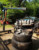 Hanging Car Engine. A car engine hanging from a lift Royalty Free Stock Photography