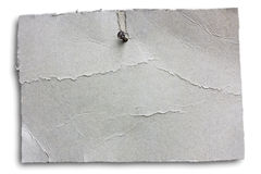 Hanging cardboard sheet - clipping path. Blank wrinkled signboard nailed, empty notice of grey cracked cardboard sheet hanging, isolated with clipping path royalty free stock images